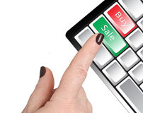 The hand presses the button. The finger of a woman's hand presses the green key Sale. Near red key Buy Royalty Free Stock Images