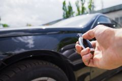 Hand presses on the remote control car alarm systems Stock Photos