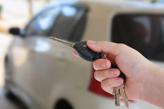 Hand presses on the remote control car alarm systems Stock Photo