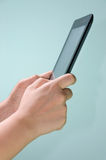 Hand presses on screen digital tablet. Studio Royalty Free Stock Photos