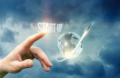 The hand presses the start up button . Royalty Free Stock Images