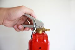 Hand presses the trigger fire extinguisher Stock Photo