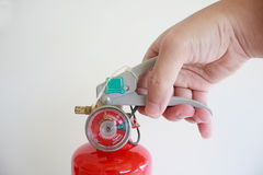 Hand presses the trigger fire extinguisher Stock Images