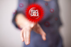 Hand pressing BIG SALE button Royalty Free Stock Images