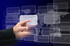 Hand pressing a button. On world map Stock Photo