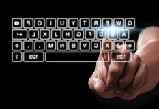 Hand pressing on button of digital virtual keyboard Royalty Free Stock Image