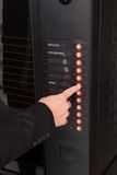 Hand pressing button of vending machine for coffee Stock Images