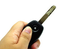 Hand Pressing Car Key on White Background Royalty Free Stock Photo