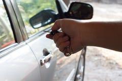 Hand pressing car remote control Stock Photo