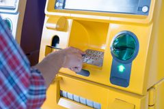 Hand pressing the code from the ATM focuses on the numbers and the finger area royalty free stock photo