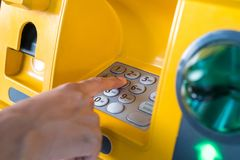 Hand pressing the code from the ATM focuses on the numbers and the finger area royalty free stock photography