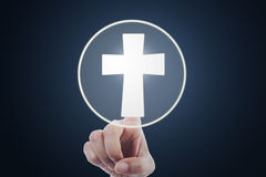 Hand pressing a cross symbol on virtual screen Royalty Free Stock Images