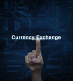 Hand pressing dollar currency exchange word on blue currency bac Stock Photography