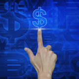 Hand pressing dollar currency icon on blue background Royalty Free Stock Photos