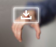 Hand pressing download button Royalty Free Stock Image