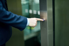 Hand pressing elevator button Stock Image