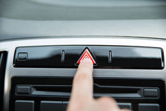Hand Pressing Emergency Stop Button In Car Royalty Free Stock Photo