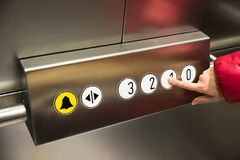 Hand pressing first floor in elevator Royalty Free Stock Image