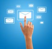 Hand pressing futuristic mail symbol Stock Image