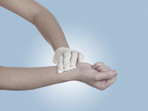 Hand pressing gauze on arm. Stock Photo