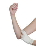 Hand pressing gauze on arm after administering an injection. Stock Photography
