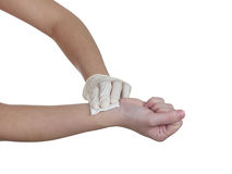 Hand pressing gauze on arm after administering an injection. Isolated on white Stock Image