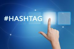Hashtag. Hand pressing Hashtag button on interface with blue background Stock Image
