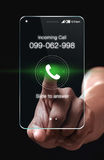Hand pressing Incoming call icon on smartphone Stock Image