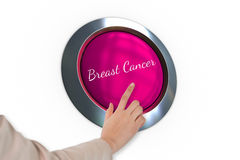 Hand pressing pink button for breast cancer awareness Stock Photos