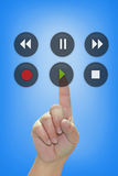 Hand pressing Play button. Hand pressing Play audio button Royalty Free Stock Photo