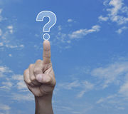 Hand pressing question mark sign icon over sky Stock Image