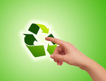 Hand pressing recycle icon Stock Photography