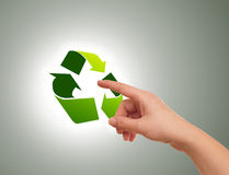 Hand pressing recycle icon Stock Photo