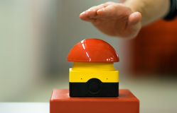 Hand pressing red buzzer Royalty Free Stock Image