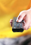 Hand pressing remote control Stock Images