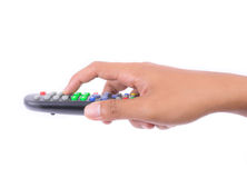 Hand pressing remote control Royalty Free Stock Images