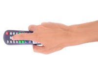 Hand pressing remote control  isolate Stock Images