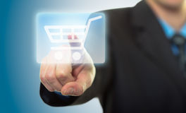 Hand pressing shopping cart icon Stock Photo