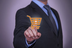 Hand Pressing Shopping Cart icon on screen Royalty Free Stock Photo