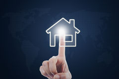 Hand pressing smart house symbol. Image of female hand pressing a smart house button on the virtual screen Stock Image