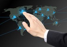 Hand pressing social network button Stock Photo