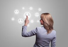 Hand pressing social network icon Stock Photos