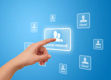 Hand pressing social network icon Royalty Free Stock Image