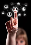 Hand pressing social network icon. Woman hand pressing social network icon Royalty Free Stock Image