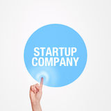 Hand pressing startup company touchscreen button Royalty Free Stock Images