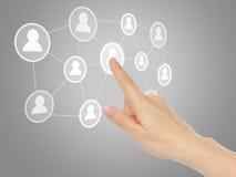 Hand pressing virtual social media icon Royalty Free Stock Photos
