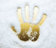 Hand print in artificial snow Royalty Free Stock Photo