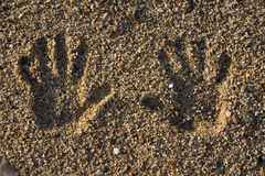Hand print on the beach. Hand print on the rocky beach Royalty Free Stock Photos