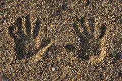 Hand print on the beach Royalty Free Stock Photos