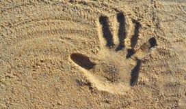 Hand Print on Beach Sand. A hand printed on beach sand with left copy space Royalty Free Stock Photos